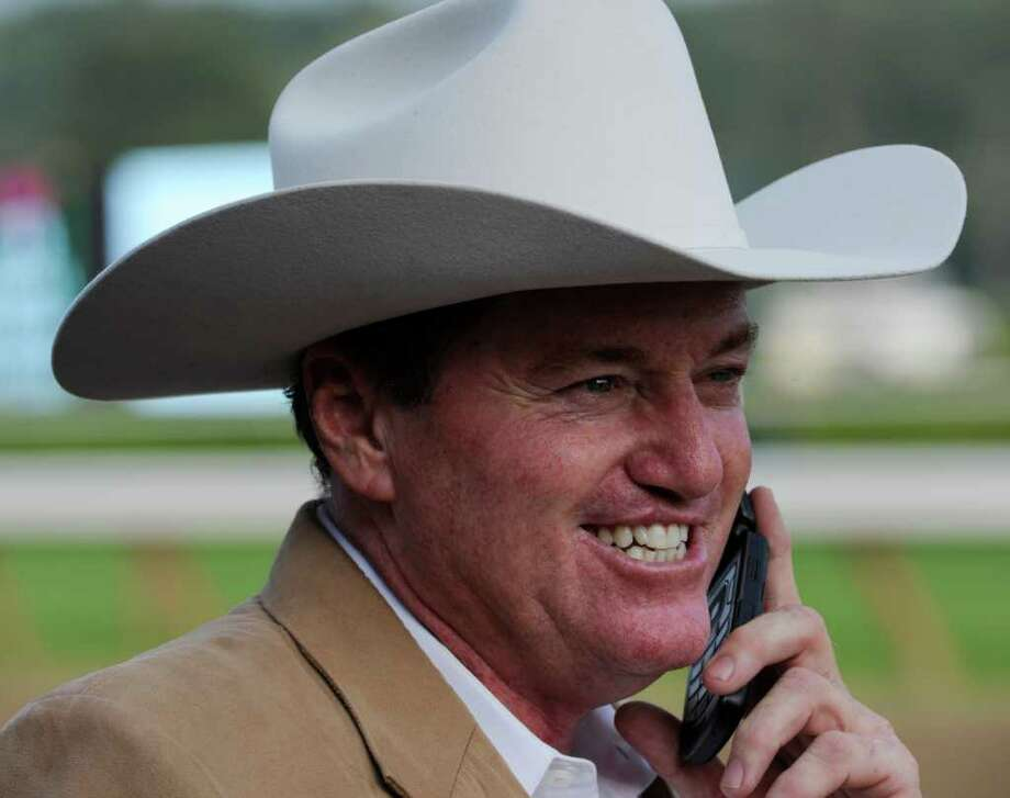 Larry Jones trainer of Havre de Grace is all smiles as he talks to his wife after his trainee won the 58th running of The Woodward at the Saratoga Race Course in Saratoga Springs, N.Y. Sept 3, 2011.    (Skip Dickstein / Times Union) Photo: SKIP DICKSTEIN