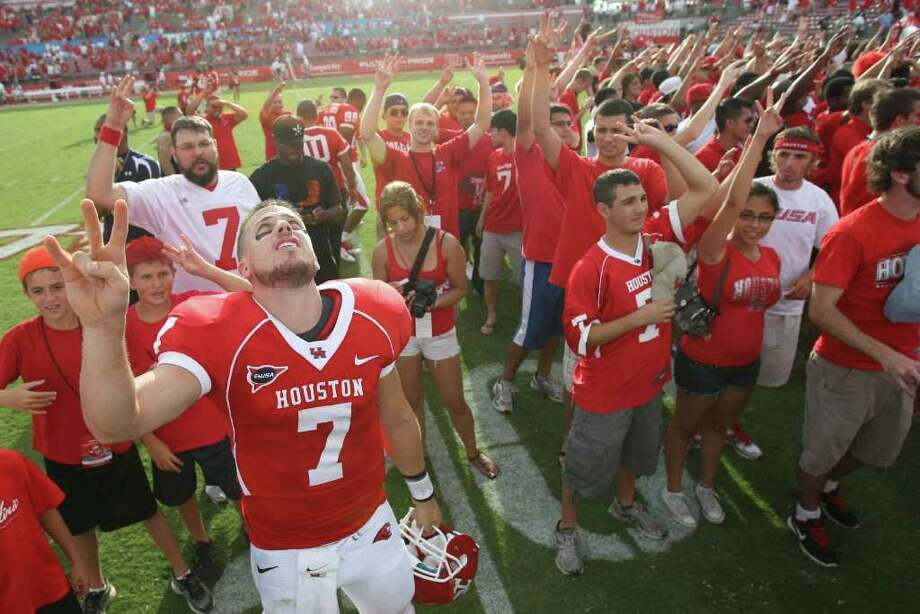 University of Houston quarterback Case Keenum (7) looks up as the University of Houston school song is played after beating UCLA 38-34 in a NCAA football game, Saturday, Sept. 3, 2011, in Robertson Stadium in Houston. Photo: Nick De La Torre, Houston Chronicle / © 2011 Houston Chronicle