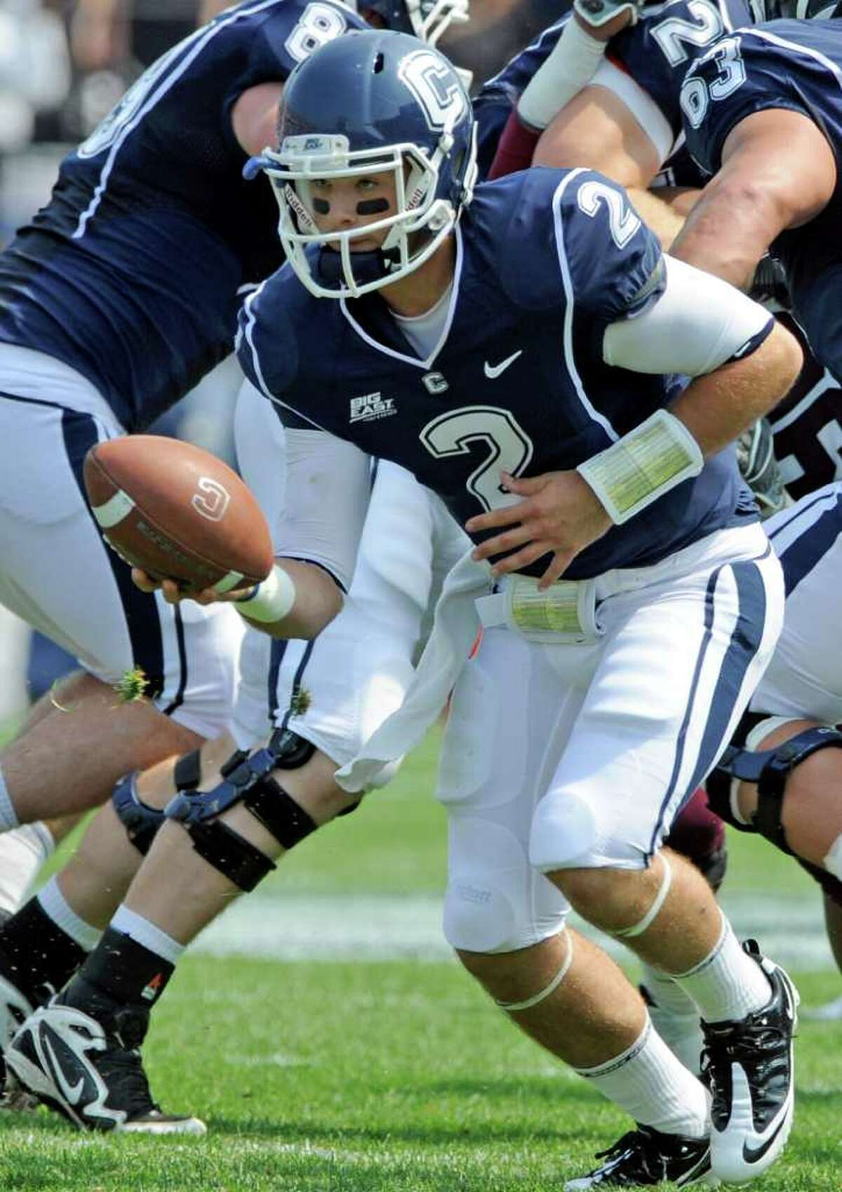Connecticut's Mike Nebrich hands the ball off during his team's 35-3 victory over Fordham, in an NCAA college football game in East Hartford, Conn., on Saturday, Sept. 3, 2011.