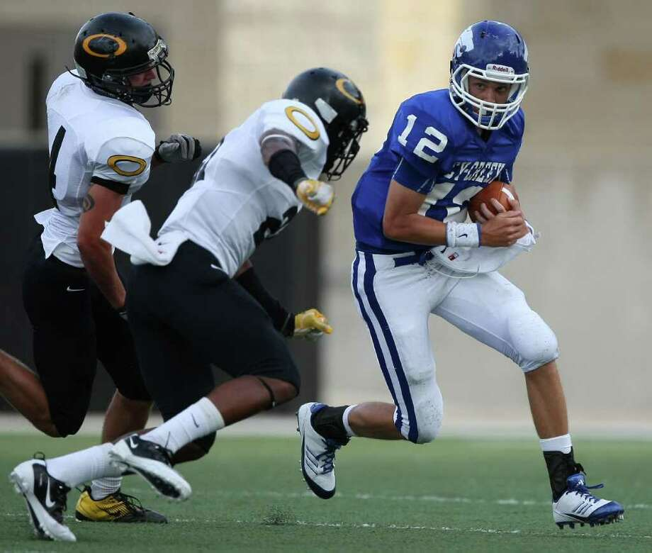 Cy-Creek's Brandon Pryor (right) looks for running room as Klein Oak's Dashone Smith (21) closes in . (Eric Christian Smith for the Chronicle) Photo: Eric Christian Smith, For The Chronicle