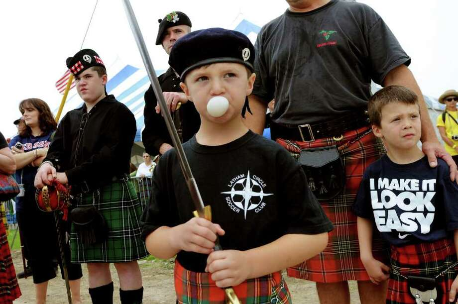 Ben Montimurro, 6, of Latham, center, blows a bubble while he represents the Maclean Clan with his family during the Scottish Games on Saturday, Sept. 3, 2011, at Altamont Fairgrounds in Altamont, N.Y. (Cindy Schultz / Times Union) Photo: Cindy Schultz