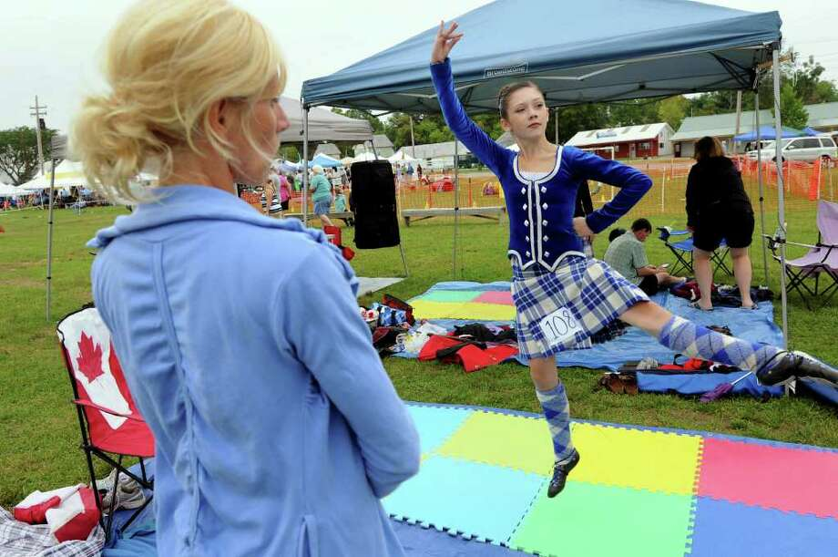 Sophie Dunn, 11, of Ontario, Canada, right, practices her Scottish dance as her mother, Gillian, watches during the Scottish Games on Saturday, Sept. 3, 2011, at Altamont Fairgrounds in Altamont, N.Y. (Cindy Schultz / Times Union) Photo: Cindy Schultz