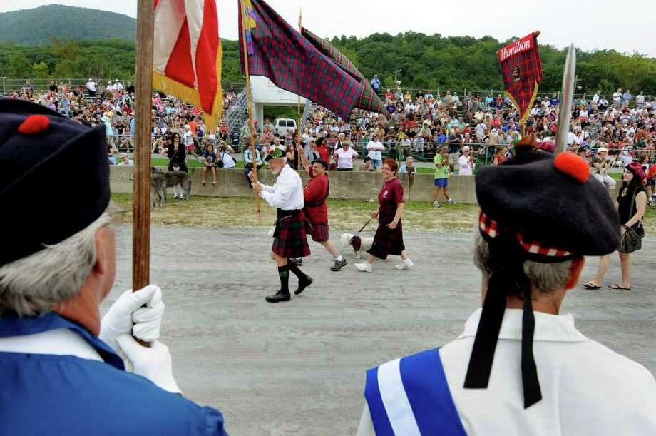 Scottish clans parade past the grandstand during the Scottish Games on Saturday, Sept. 3, 2011, at Altamont Fairgrounds in Altamont, N.Y. (Cindy Schultz / Times Union) Photo: Cindy Schultz