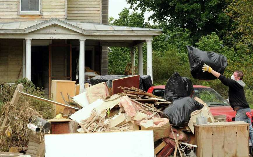 Piles of flood destroyed items and home debris build up along Route 30 in the Town of Schoharie NY S