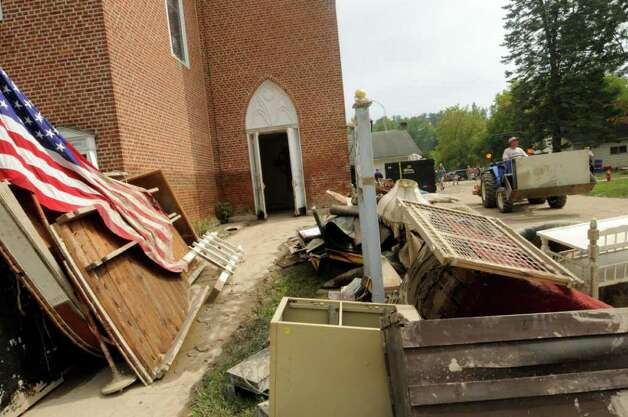 The United Presbyterian Church on Main Street continues the decontamination and clean up process in the Town of Schoharie NY Saturday Sept.3, 2011. ( Michael P. Farrell/Times Union) Photo: Michael P. Farrell