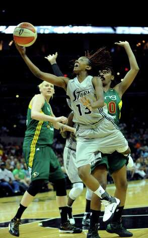 The Silver Stars' Danielle Robinson shoots a layup against the Seattle Storm during WNBA action at the AT&T Center on Saturday, Sept. 3, 2011. BILLY CALZADA / gcalzada@express-news.net  Seattle Storm at San Antonio Silver Stars / gcalzada@express-news.net