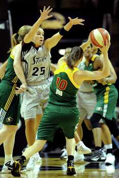 Becky Hammon of the San Antonio Silver Stars (25) attempts to defend as Sue Bird of the Seattle Storm looks to pass during WNBA action at the AT&T Center on Saturday, Sept. 3, 2011. BILLY CALZADA / gcalzada@express-news.net