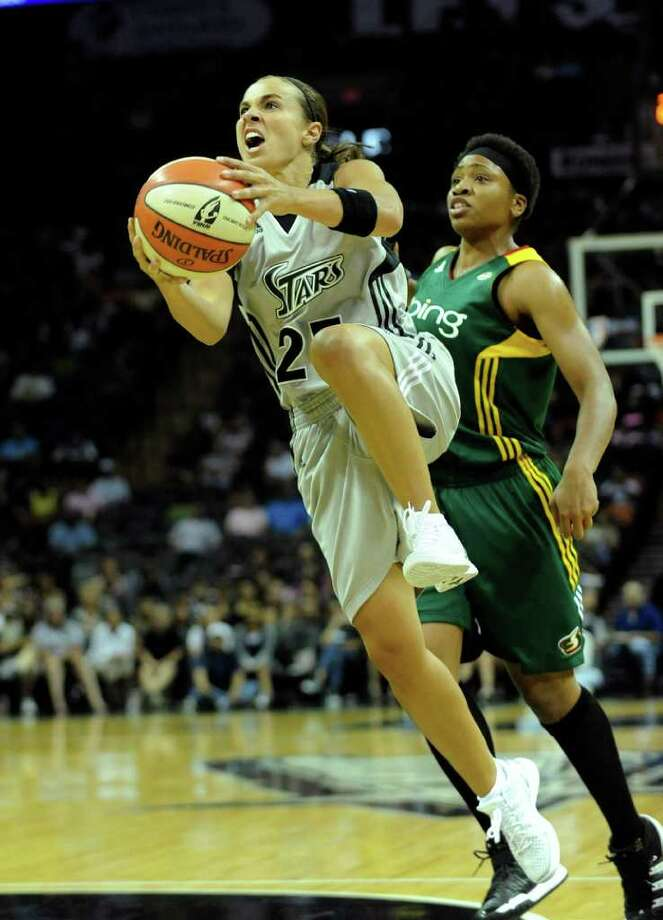 Becky Hammon of the San Antonio Silver Stars penetrates by Tanisha Wright of the Seattle Storm during WNBA action at the AT&T Center on Saturday, Sept. 3, 2011. BILLY CALZADA / gcalzada@express-news.net  Seattle Storm at San Antonio Silver Stars Photo: BILLY CALZADA, Express-News / gcalzada@express-news.net