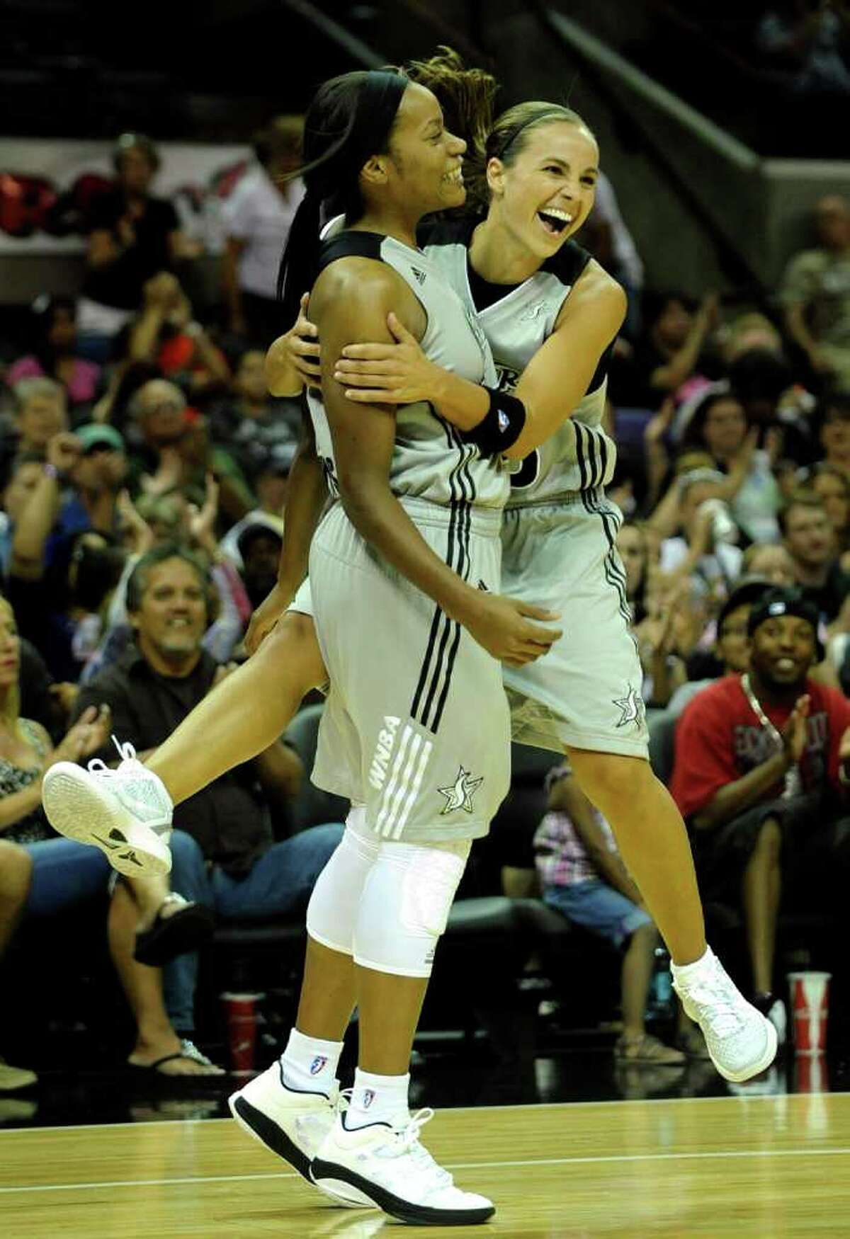 Guard Becky Hammon (right), rejoicing after a basket by Jia Perkins on Saturday against Seattle, says the Silver Stars need to take care of business to make the playoffs.