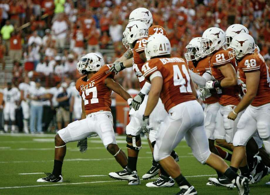 AUSTIN, TX - SEPTEMBER 3:  Cornerback Adrian Phillips #17 of the Texas Longhorns celebrates a fumble recovery against the Rice Owls on September 3, 2011 at Darrell K. Royal-Texas Memorial Stadium in Austin, Texas. Photo: Erich Schlegel, Getty / 2011 Getty Images