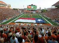 """AUSTIN, TX - SEPTEMBER 3:  Fans sing """"The Eyes of Texas"""" before the start of the NCAA game between the Texas Longhorns and the Rice Owls on September 3, 2011 at Darrell K. Royal-Texas Memorial Stadium in Austin, Texas."""