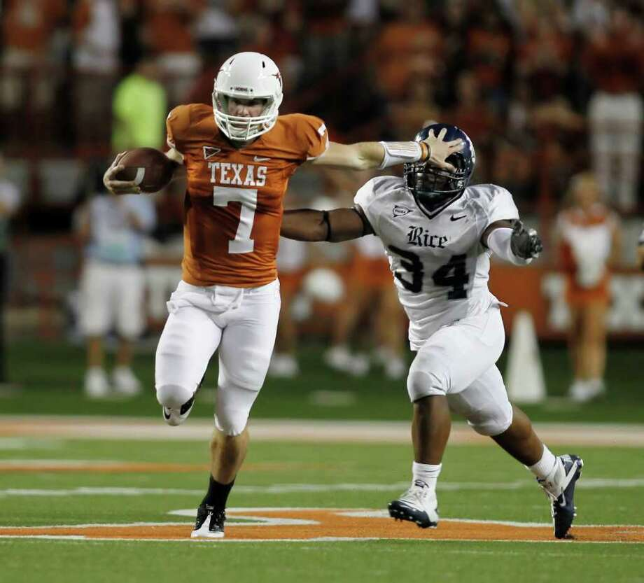 Quarterback Garrett Gilbert made several big plays against Rice. Photo: Erich Schlegel, Getty / 2011 Getty Images
