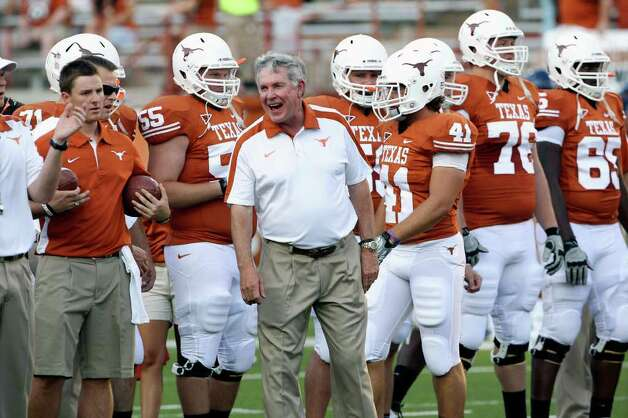 Mack Brown enjoys the pregame warmup as the Texas Longhorns play the Rice Owls at Darrell K. Royal memorial Stadium on September 3, 2011.  Tom Reel/Staff Photo: TOM REEL, Express-News / © 2011 San Antonio Express-News