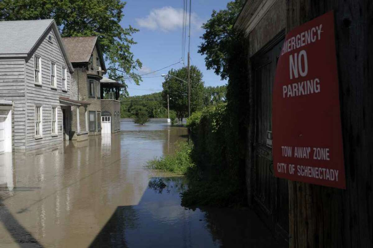 A section of Governor's Lane is flooded in the Stockade section of Schenectady as the Mohawk River overflowed its banks flooding homes in this section of the city on Monday, Aug. 29, 2011. (Paul Buckowski / Times Union)