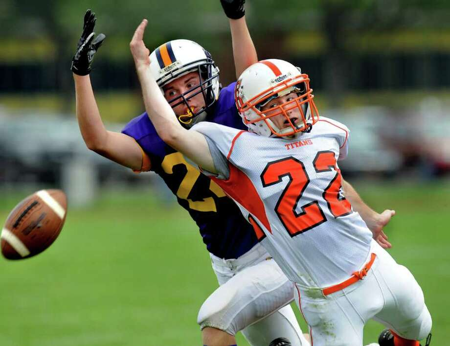 Voorheesville's Casey Hennessy (24), left, and Taconic Hills' Jon Luck (22), right, both miss the pass intended for Hennessy during their football game on Saturday, Sept. 3, 2011, at Voorheesville Hill in Voorheesville, N.Y. (Cindy Schultz / Times Union) Photo: Cindy Schultz