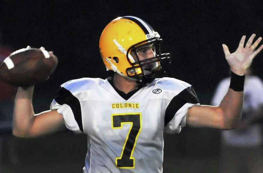 Colonie High's QB Steve Wutzer gets a pass off against Schenectady High during Saturday night's game in Schenectady Sept. 3, 2011.  (John Carl D'Annibale / Times Union) Photo: John Carl D'Annibale / 00014465A