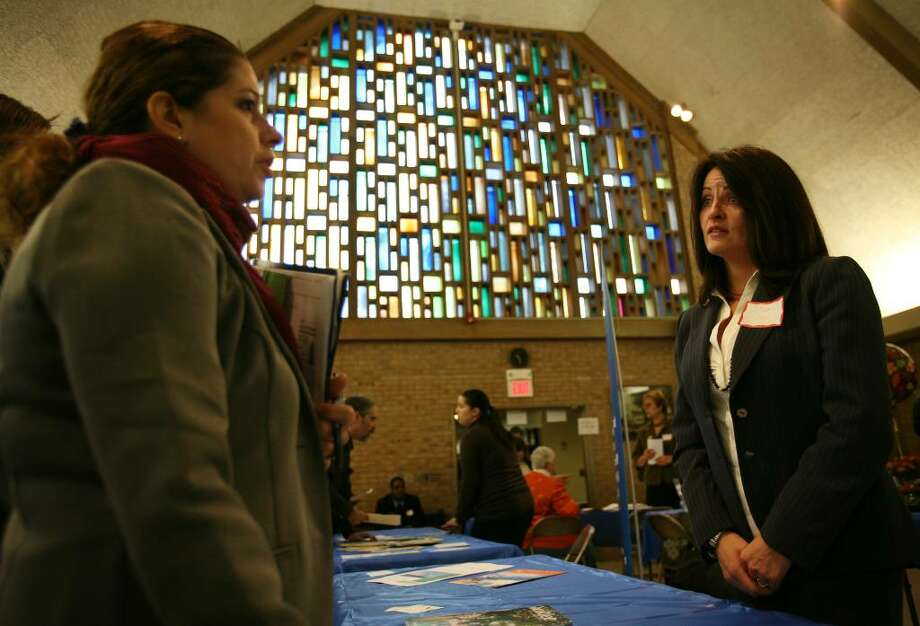 Yvette Novack, left of Stratford, talks with Shaklee representative Sharon See at the Faith for the Future Job Fair 2009 at the Christ Episcopal Church Hall at 200 Main Street in Stratford, Conn. on Thursday, October 15, 2009. Photo: Brian A. Pounds / Connecticut Post