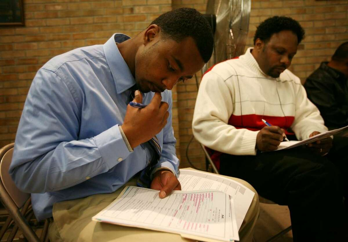 Jesse Goodwin, left of Bridgeport and Kenneth Jacobs of New Haven fill out job applications at the Faith for the Future Job Fair 2009 at Christ Episcopal Church Hall in Stratford, Conn. on Thursday, October 15, 2009.