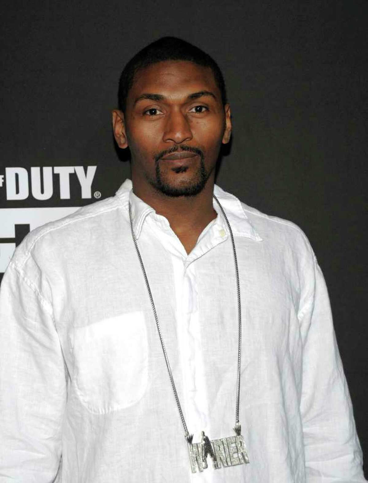 Athlete Ron Artest arrives at the Call of Duty: Modern Warfare 3 launch party in Los Angeles on Saturday, Sept. 3, 2011. (AP Photo/Dan Steinberg)