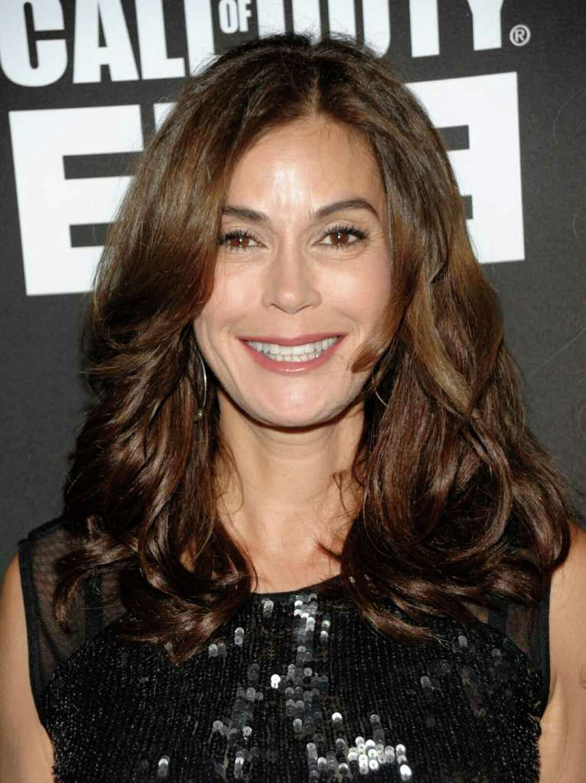 Actress Teri Hatcher arrives at the Call of Duty: Modern Warfare 3 launch party in Los Angeles on Saturday, Sept. 3, 2011. (AP Photo/Dan Steinberg)