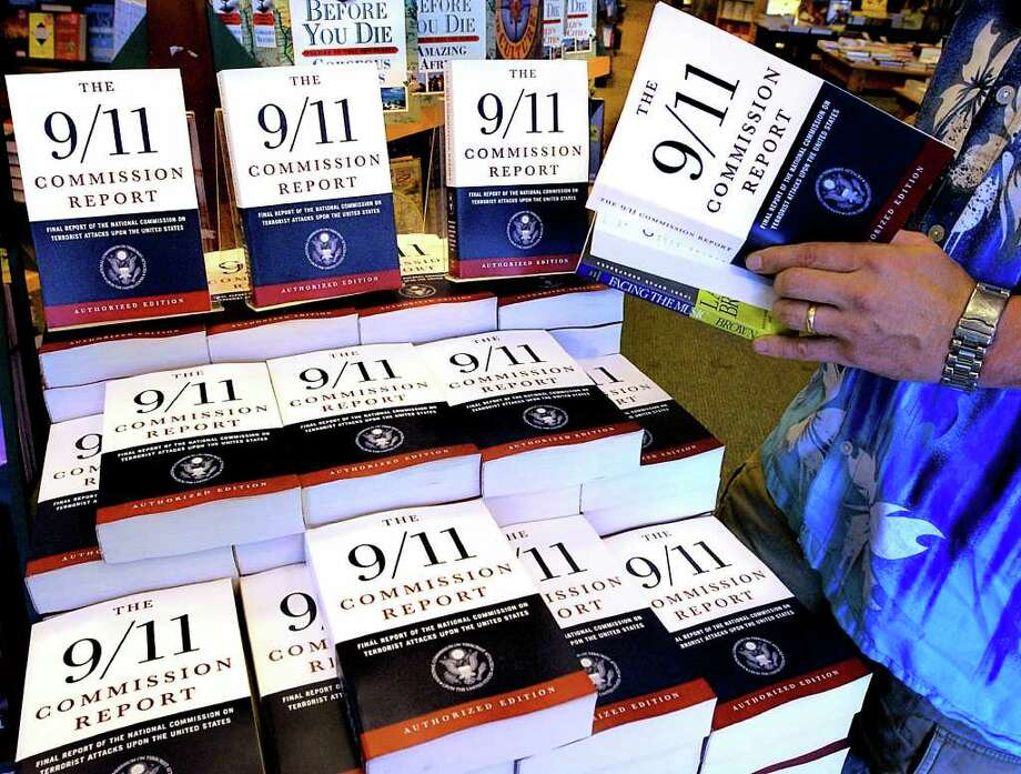 SETH PERLMAN : ASSOCIATED PRESS FILE A BEST SELLER: The 9/11 Commission Report was being read across the nation in July 2004. Many of the recommendations are reality, but some haven't lived up to expectations. Photo: Seth Perlman, STF / AP