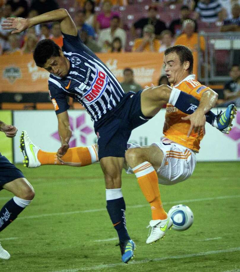 Houston Dynamo forward Cam Weaver, right, gets tangles up with CF Monterrey defender Ricardo Osorio during the first half of a friendly match on Sunday, Sept. 4, 2011, at Roberston Stadium in Houston. Photo: Smiley N. Pool, Houston Chronicle / © 2011  Houston Chronicle