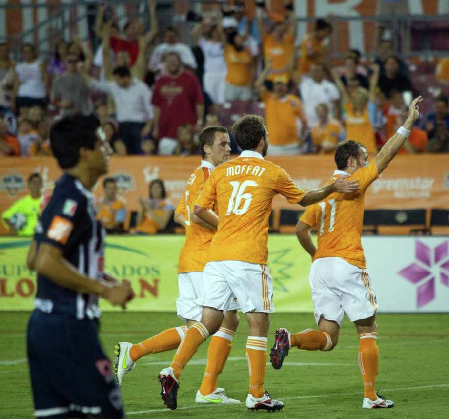 Dynamo midfielder Brad Davis (11) celebrates after scoring on a penalty kick against CF Monterrey during the first half of Saturday's friendly match at Robertson Stadium. The Dynamo won 3-0. Photo: Smiley N. Pool, Houston Chronicle / © 2011  Houston Chronicle