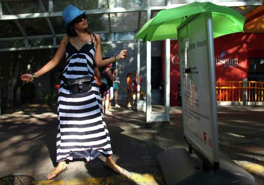 Marie Matiko of Silicon Valley dances to the sound of Das Racist. Photo: JOSHUA TRUJILLO / SEATTLEPI.COM