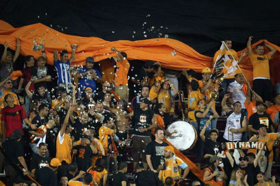 Dynamo fans cheer on their team against CF Monterrey. Photo: Smiley N. Pool, Houston Chronicle / © 2011  Houston Chronicle