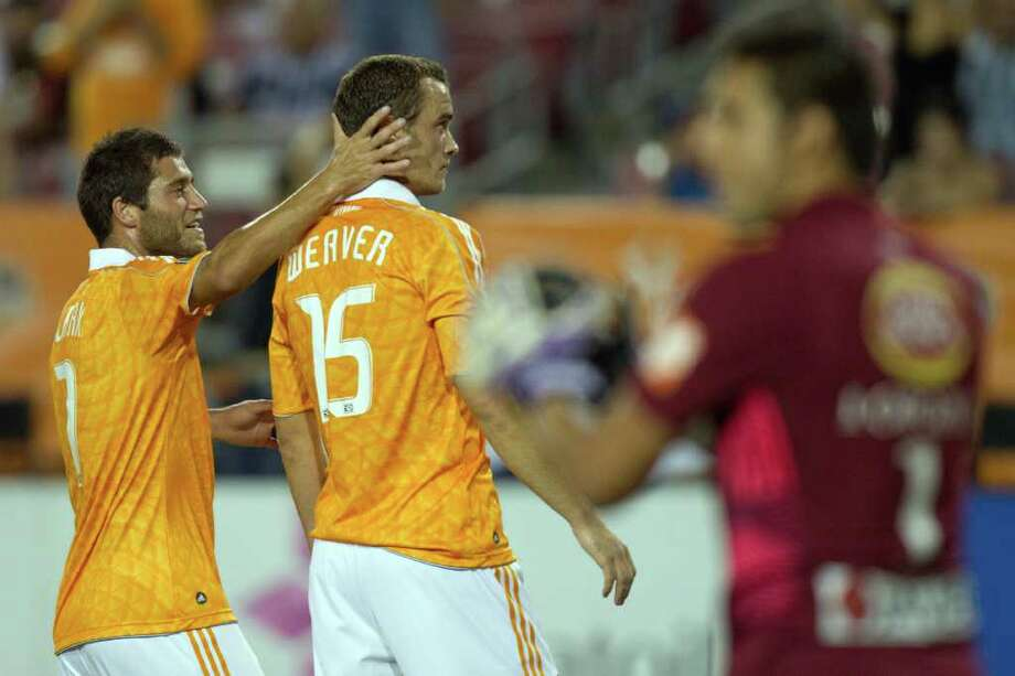 Dynamo forward Cam Weaver (15) celebrates with Colin Clark after scoring against CF Monterrey during the first half. Photo: Smiley N. Pool, Houston Chronicle / © 2011  Houston Chronicle