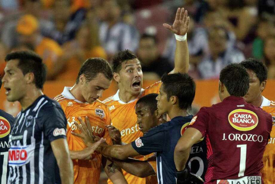 Dynamo defender Geoff Cameron, center, yells toward CF Monterrey goalkeeper Jonathan Orozco (1) as tempers flare during the first half. Photo: Smiley N. Pool, Houston Chronicle / © 2011  Houston Chronicle