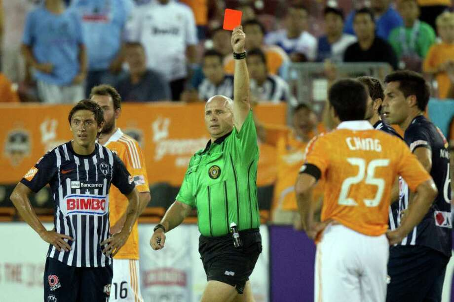 Referee Jasen Anno  issues a red card against CF Monterrey midfielder Luis Ernesto Perez during the first half. Photo: Smiley N. Pool, Houston Chronicle / © 2011  Houston Chronicle