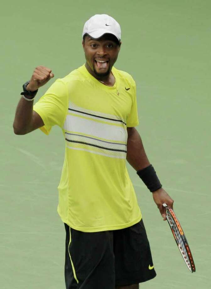 Donald Young reacts after winning his match against Juan Ignacio Chela of Argentina during the U.S. Open tennis tournament in New York, Sunday, Sept. 4, 2011. (AP Photo/Charlie Riedel) Photo: Charlie Riedel, STF / AP
