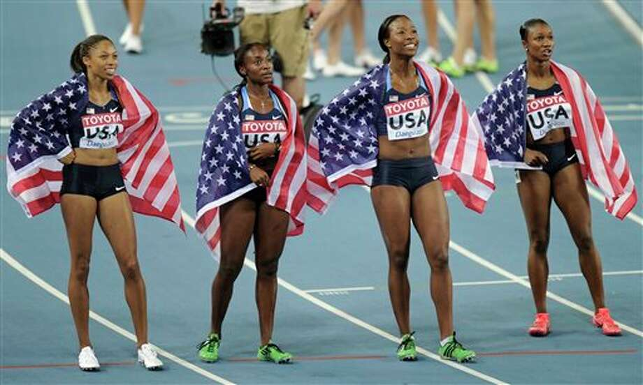 From left, USA's Allyson Felix, Bianca Knight, Marshevet Myers and Carmelita Jeter celebrate after winning gold in the Women's 4x100m Relay final at the World Athletics Championships in Daegu, South Korea, Sunday, Sept. 4, 2011. (AP Photo/Martin Meissner) Photo: Martin Meissner, Associated Press / AP2011