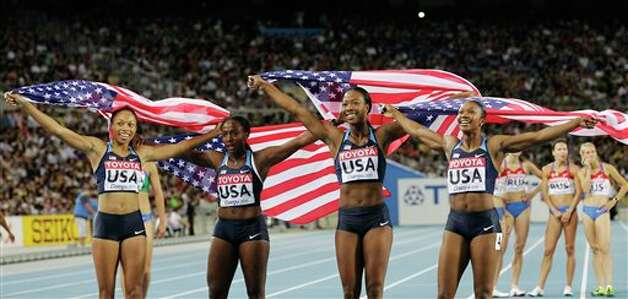 From left, USA's Allyson Felix, Bianca Knight, Marshevet Myers and Carmelita Jeter celebrate after winning gold in the Women's 4x100m Relay final at the World Athletics Championships in Daegu, South Korea, Sunday, Sept. 4, 2011. (AP Photo/Anja Niedringhaus) Photo: Anja Niedringhaus, Associated Press / AP