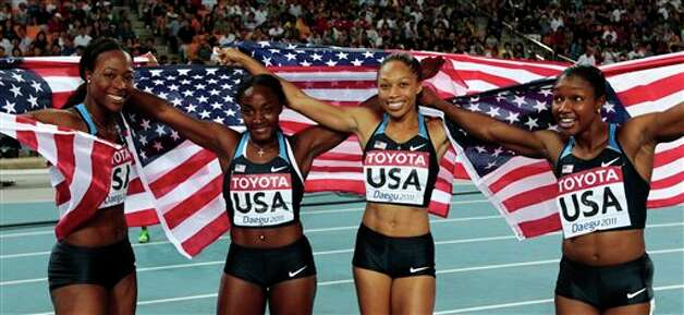 From left, USA's Marshevet Myers, Bianca Knight, Allyson Felix and Carmelita Jeter celebrate after winning gold in the Women's 4x100m Relay final at the World Athletics Championships in Daegu, South Korea, Sunday, Sept. 4, 2011. (AP Photo/David J. Phillip) Photo: David J. Phillip, Associated Press / AP