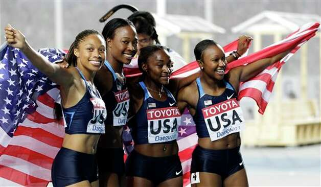 From left, USA's Allyson Felix, Marshevet Myers, Bianca Knight, and Carmelita Jeter celebrate winning the Women's 4x100m Relay final at the World Athletics Championships in Daegu, South Korea, Sunday, Sept. 4, 2011. (AP Photo/Lee Jin-man) Photo: Lee Jin-man, Associated Press / AP