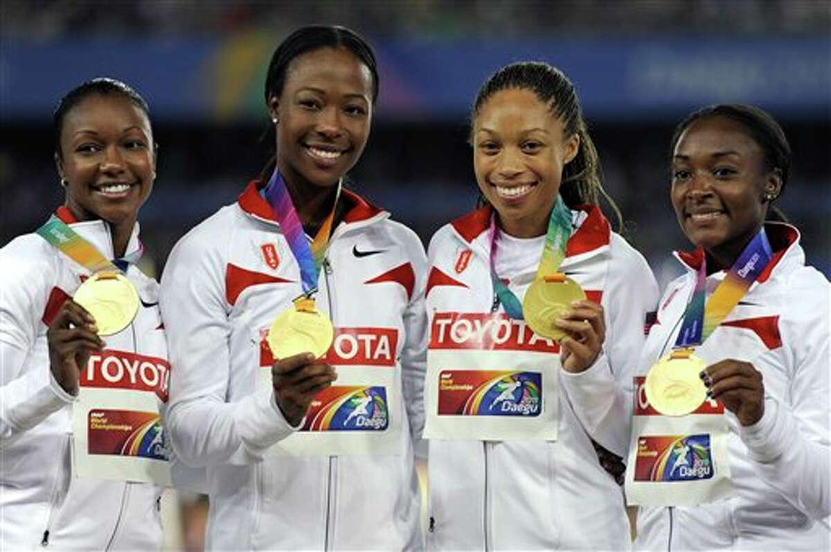 From left, USA's Carmelita Jeter, Marshevet Myers, Allyson Felix and Bianca Knight, pose with the gold medal during the medal ceremony of the Women's 4x100m relay final at the World Athletics Championships in Daegu, South Korea, Sunday, Sept. 4, 2011. (AP Photo/Martin Meissner)
