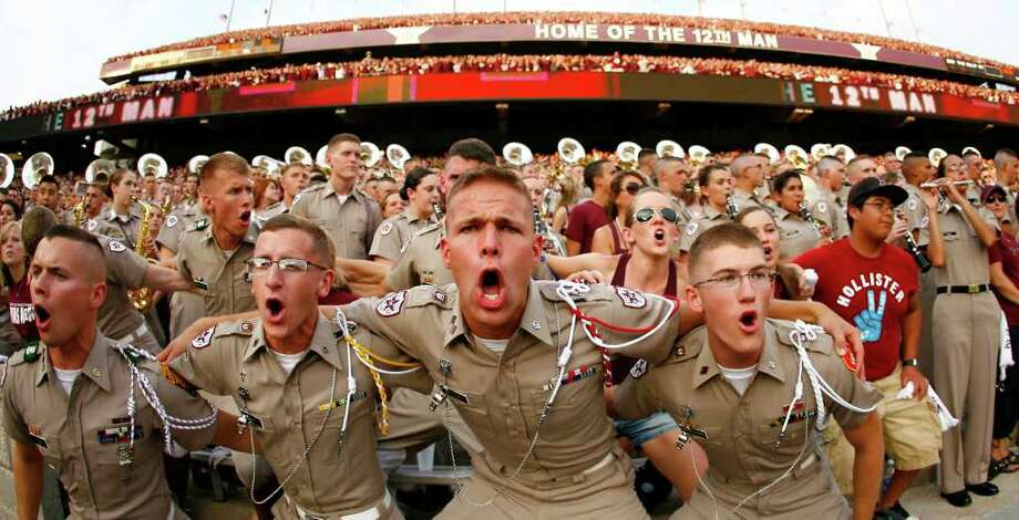 Texas A&M cadet Mark Jessup, of Meadows Place, Texas, sings the Aggie War Hymn, before against Southern Methodist a NCAA football game, Sunday, Sept. 4, 2011, in Kyle Field in College Station. Photo: Nick De La Torre, Houston Chronicle / © 2011 Houston Chronicle