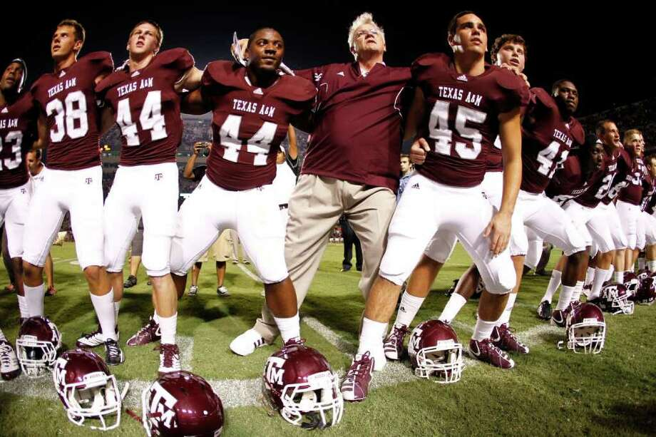 Texas A&M head coach Mike Sherman stands with his players as the Aggie War Hymn is played after beating Southern Methodist 46-14 in a NCAA football game, Sunday, Sept. 4, 2011, in Kyle Field in College Station. Photo: Nick De La Torre, Houston Chronicle / © 2011 Houston Chronicle