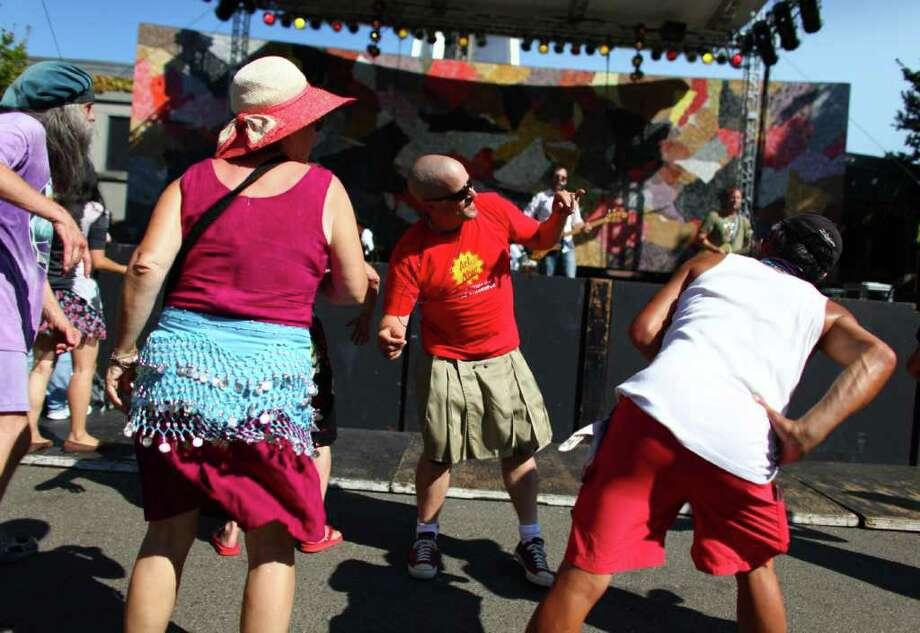 People dance to Massy Ferguson at the Starbucks Stage. Photo: JOSHUA TRUJILLO / SEATTLEPI.COM