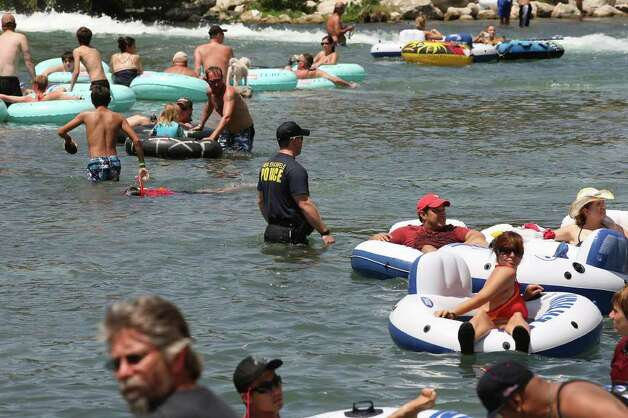 New Braunfels Police Department Officer Greg Fuller takes to the water as he patrols the Comal River on Labor Day weekend, Sunday, Sept. 4, 2011. Photo: JERRY LARA, Jerry Lara/Express-News / SAN ANTONIO EXPRESS-NEWS