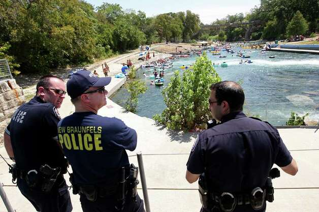 New Braunfels Police Department Chief Thomas Wibert, center, Lt. Heath Purvis, left, and Assistant Chief Joe Vargas patrol the Comal River on Labor Day weekend, Sunday, Sept. 4, 2011. The departments beefed up its patrol from a total of six dedicated officers to nearly 40 on weekend during the summer season. Photo: JERRY LARA, Jerry Lara/Express-News / SAN ANTONIO EXPRESS-NEWS