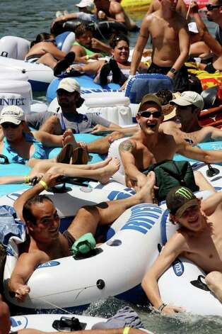 Tuber traffic clogs up at a chute on the Comal River on Labor Day weekend, Sunday, Sept. 4, 2011. The New Braunfels Police Department beefed up their weekend patrol from a unit of six to over 40 officers to insure public safety on the river. Photo: JERRY LARA, Jerry Lara/Express-News / SAN ANTONIO EXPRESS-NEWS