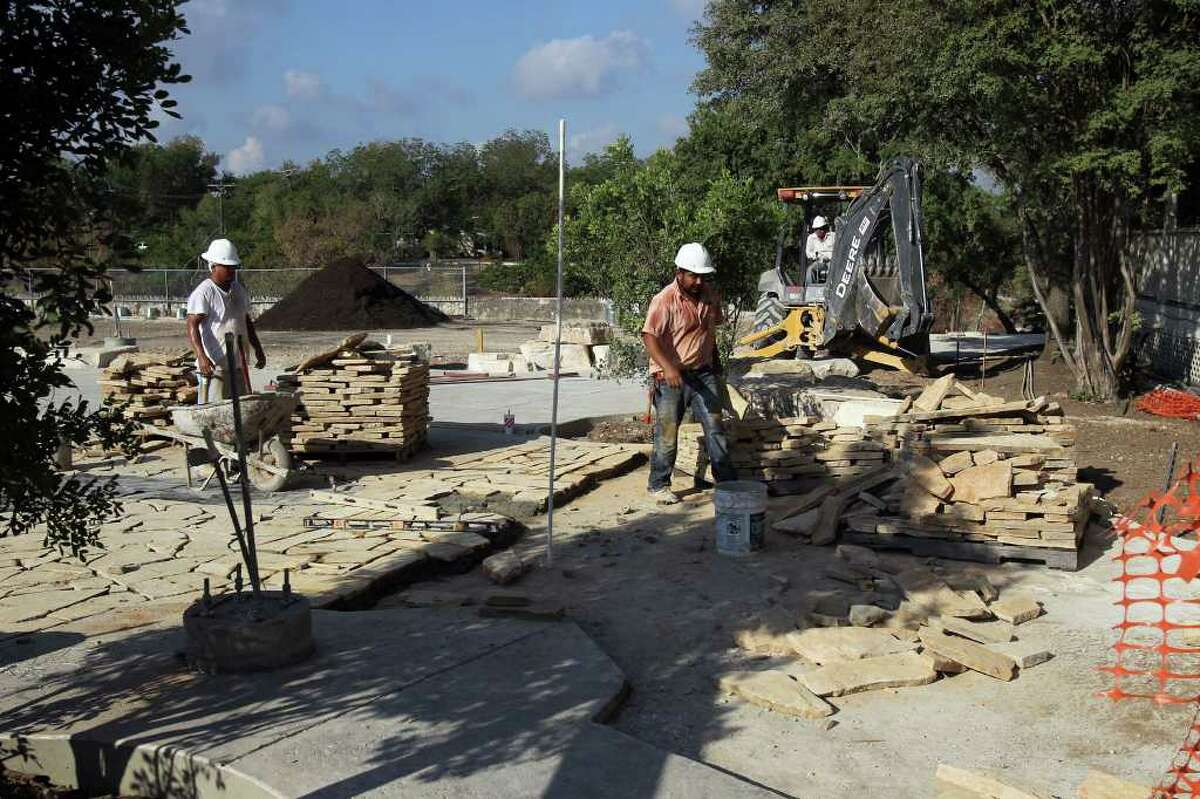"""Construction work continues on the west end of a walking trail being built near Main Plaza in Boerne, Texas that will follow Cibolo Creek to the city park on Texas 46 in Boerne. Some are calling the walk """"The Hill Country Mile."""""""