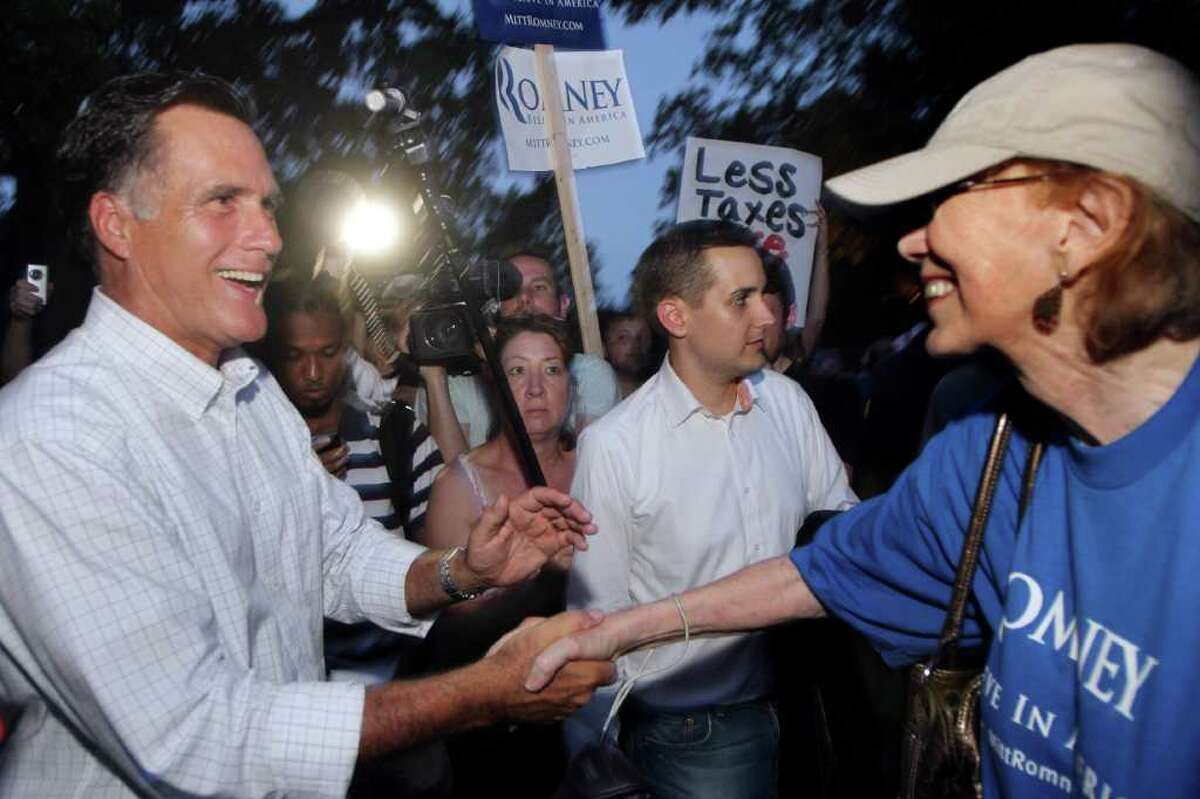 Republican presidential candidate former Massachusetts Gov. Mitt Romney is greeted by supporters after giving a speach at a Tea Party Express rally, Sunday, Sept. 4, 2011 in Concord, N.H. (AP Photo/Jim Cole)