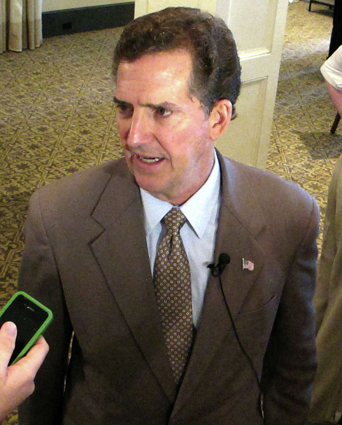 U.S. Sen. Jim DeMint, R-S.C., speaks with reporters in Charleston, S.C., on Tuesday, Aug., 30, 2011. DeMint says he has no plans at this time to seek re-election in 2016. (AP Photo/Bruce Smith)