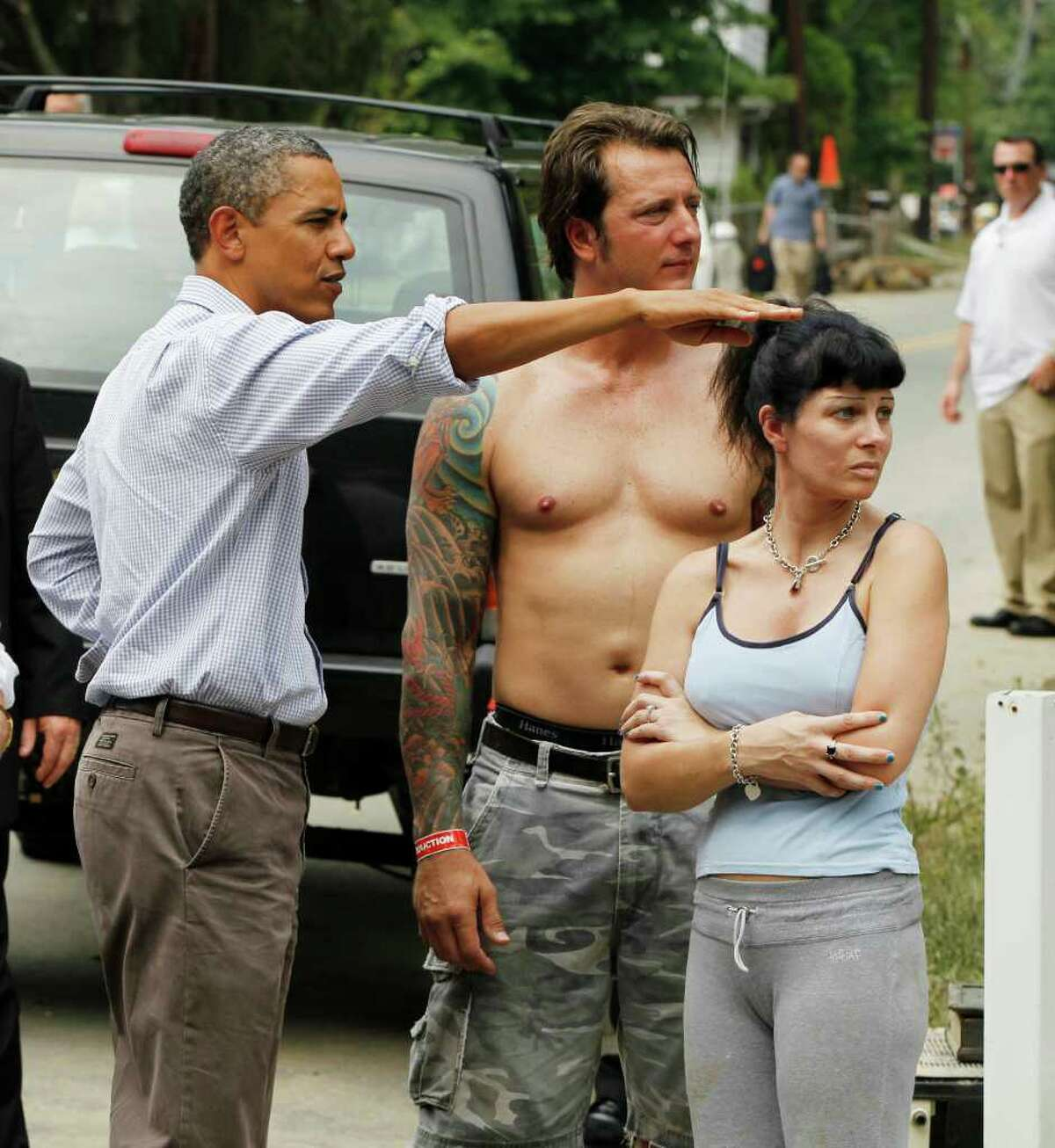 President Barack Obama meets with residents on Fayette Avenue in Wayne, N.J., Sunday, Sept. 4, 2011, as he visits flood damage caused by Hurricane Irene. (AP Photo/Charles Dharapak)