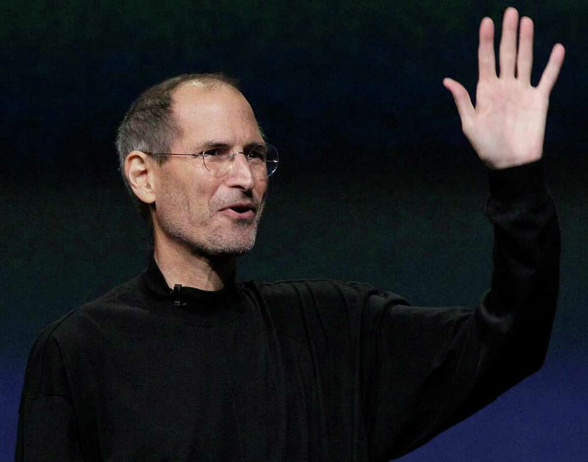 FILE - In this March 2, 2011 file photo, Apple Inc. Chairman and CEO Steve Jobs waves to his audience at an Apple event at the Yerba Buena Center for the Arts Theater in San Francisco. Apple is grappling with how to continue without Jobs, who after battling with health issues announced recently he would step down and Tim Cook would run the company. (AP Photo/Jeff Chiu, File)