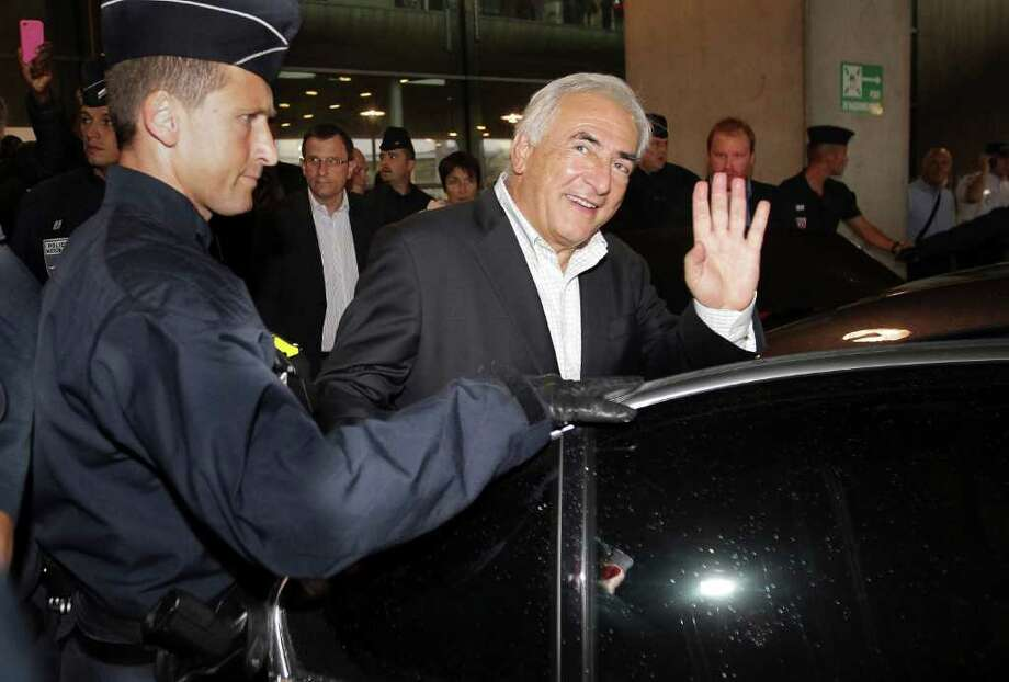 Dominique Strauss-Kahn, former head of the International Monetary Fund, waves as he leaves Roissy airport, north of Paris, France, Sunday, Sept. 4, 2011. Strauss-Kahn returned home to France for the first time since a New York hotel maid accused him of attempted rape, unleashing a scandal that dashed his chances for the French presidency.(AP Photo/Bob Edme) Photo: Bob Edme